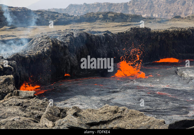Huge bubbles burst from the lava lake at Erta Ale - Stock Image