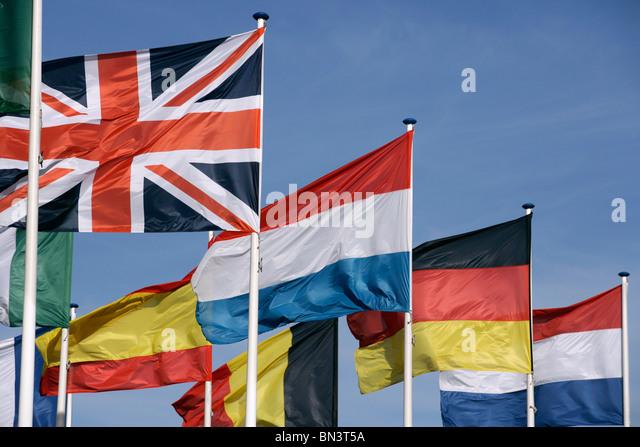 National flags fluttering against sky - Stock-Bilder