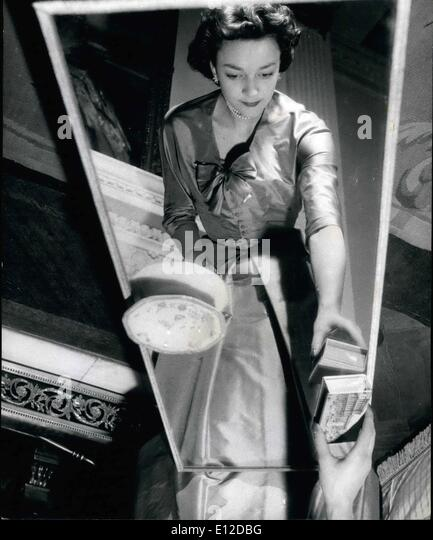 Dec. 19, 2011 - An unusual photograph of Lady Mary Baillie-Hamilton reflected in the mirror top table in the drawing - Stock-Bilder