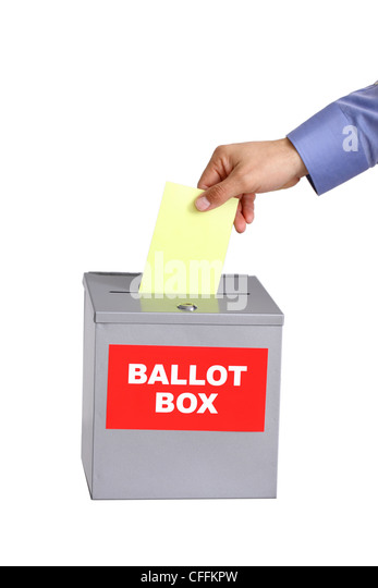 Hand putting ballot into ballot box, voting concept, cut out on white background - Stock Image