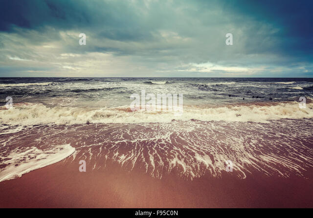 Vintage toned stormy sky over rough sea, calm before the storm concept. - Stock-Bilder