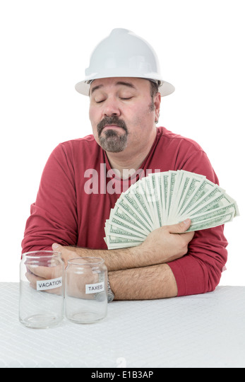Construction worker deciding if the money will be used to pay tax obligations or used for personal vacations - Stock Image