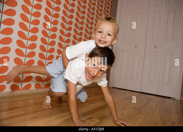 Two Young Boys Rough Housing - Stock-Bilder