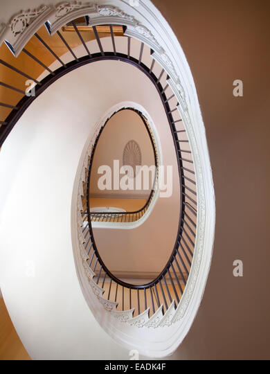 Spiraling staircase of old House. - Stock Image