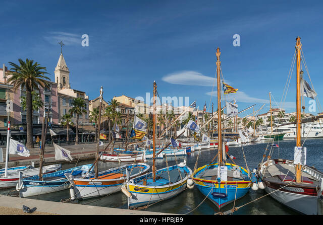 Mediterranean Fishing boats at Sanary-Sur-Mer , Promenade, Mistral Clouds, French Riviera,  Cote d Azur, France - Stock Image