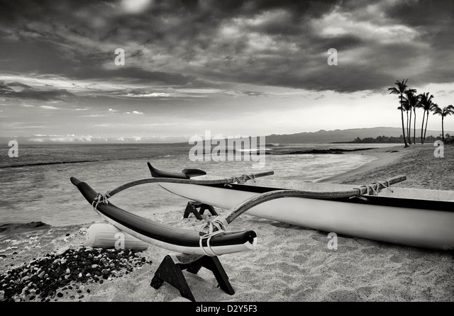 Outrigger canoe on the Kohala Coast at sunrise. The Big Island, Hawaii. - Stock Image