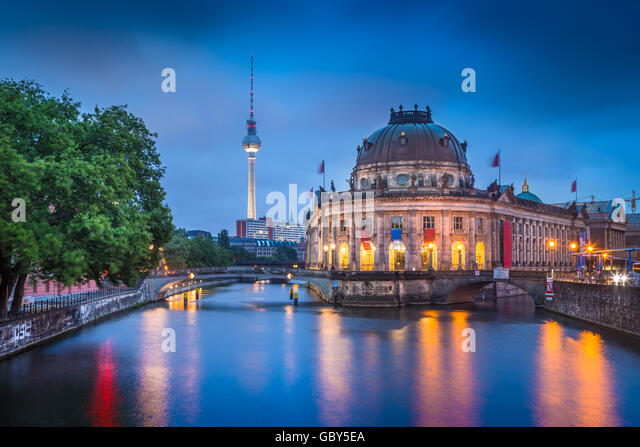 Beautiful view of historic Berlin Museumsinsel with famous TV tower and Spree river in twilight during blue hour - Stock Image