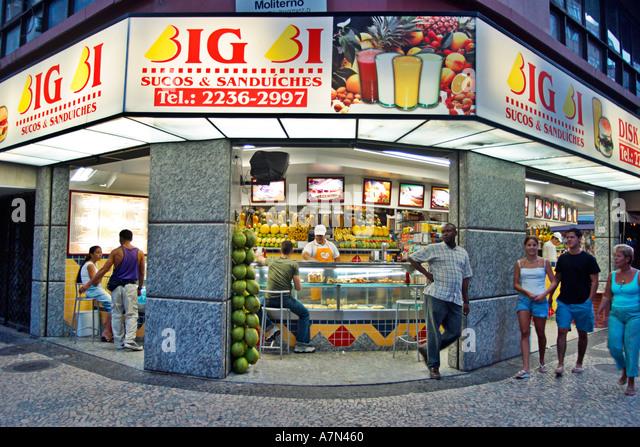 Rio de Janeiro Copacabana fruit shop cariocas dusk - Stock Image