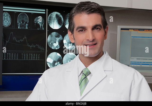 Portrait of a doctor smiling - Stock Image
