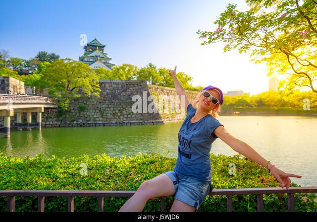 Tourist at Osaka Castle - Stock Image