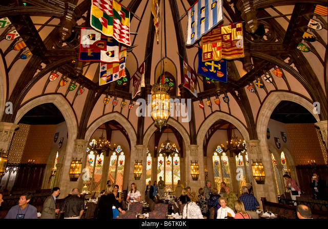 Cinderellas Royal Table restaurant colorful royal banners Magic Kingdom Walt Disney World Orlando Florida FL - Stock Image