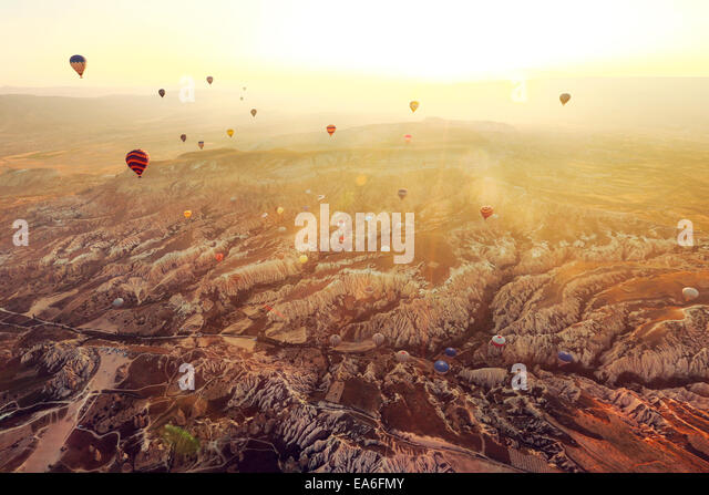 Hot air balloons flying over Cappadocia, Turkey - Stock Image