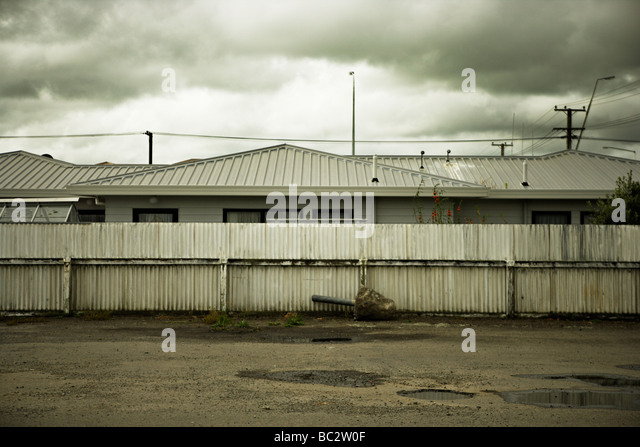 New Zealand house, fence and uprooted fence post, Foxton, Manawatu, North Island - Stock Image