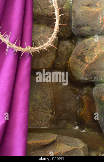 Purple cloth and crown of thorns - Stock Image