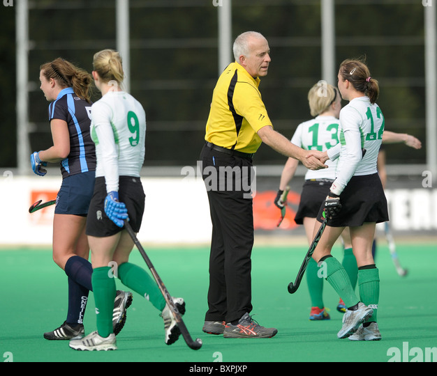 Canterbury's players shake hands with the umpires during their England Hockey League Premier Division match - Stock Image