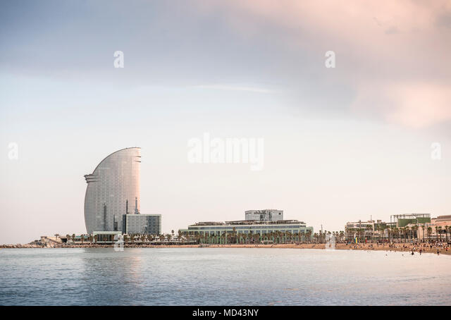 Beach with Hotel W in background, Barcelona, Catalonia, Spain - Stock Image