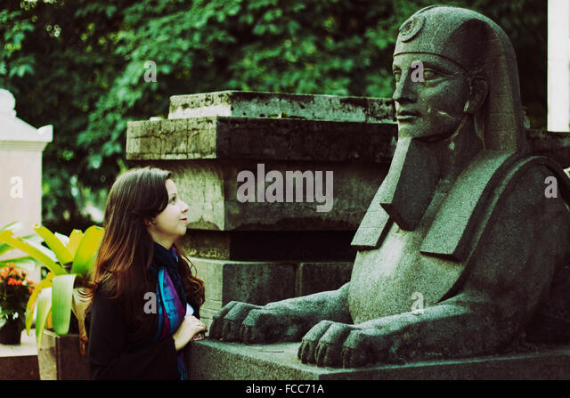 Side View Of Teenage Girl Looking At Statue - Stock Image
