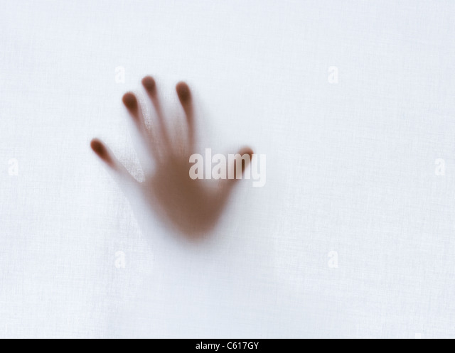 Hand behind sheet. - Stock Image