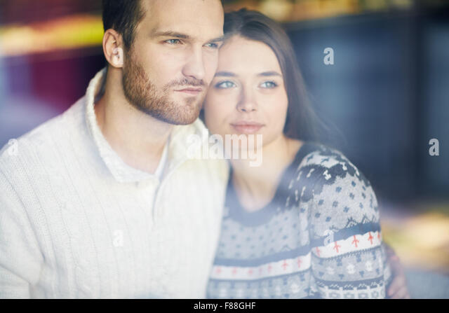 Restful young couple in sweaters - Stock Image