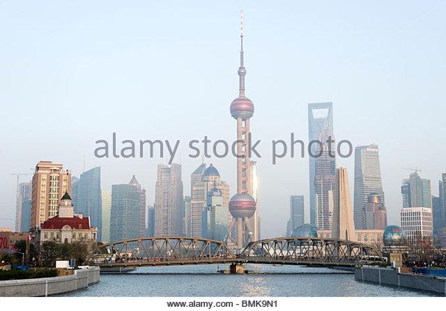 Waibaidu Qiao or Garden Bridge and city skyline, Shanghai, China - Stock Image