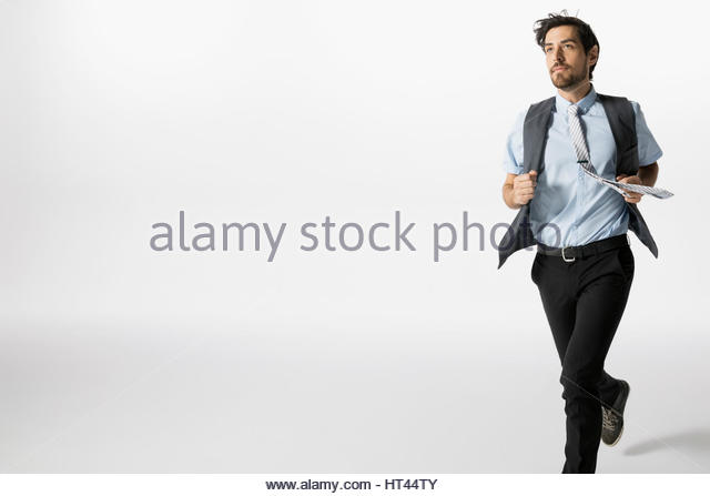 Businessman running against white background - Stock-Bilder