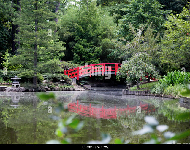 Arched japanese bridge stock photos arched japanese for Japanese style pond