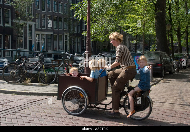 Amsterdam mother with childs on a bicycle with sidecar - Stock Image