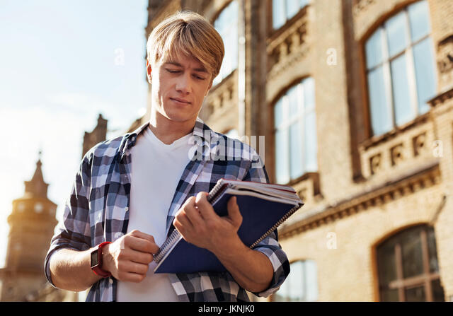 Productive handsome man looking at the schedule - Stock Image