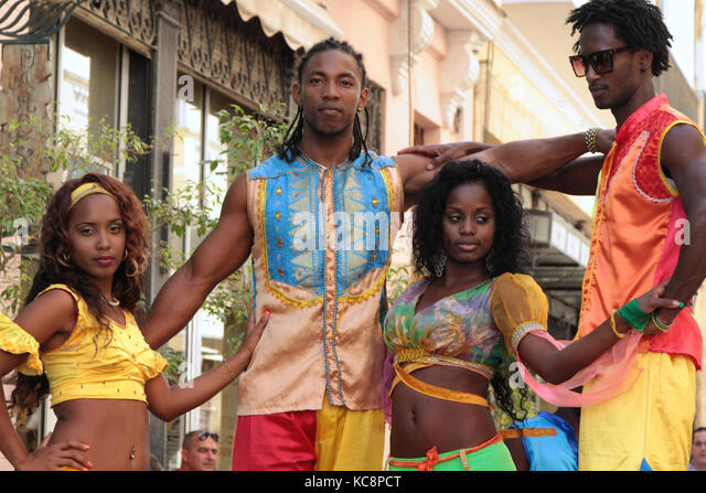 HAVANA, CUBA, FEBRUARY 16, 2014 : Group of stilt dancers in the streets of Havana. Havana is the largest city in - Stock Image
