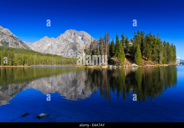 Reflections in Leigh Lake, Grand Teton National Park, Wyoming, United States of America, North America - Stock Image