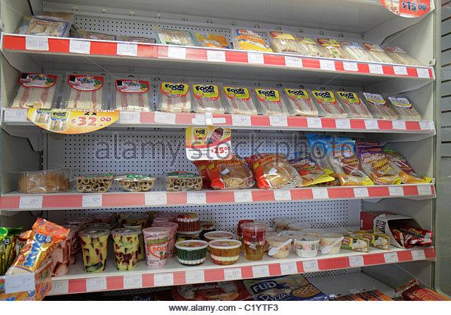 Cancun Mexico Yucatán Peninsula Quintana Roo Avenida Coba Oxxo business convenience store shelf shelves retail - Stock Image