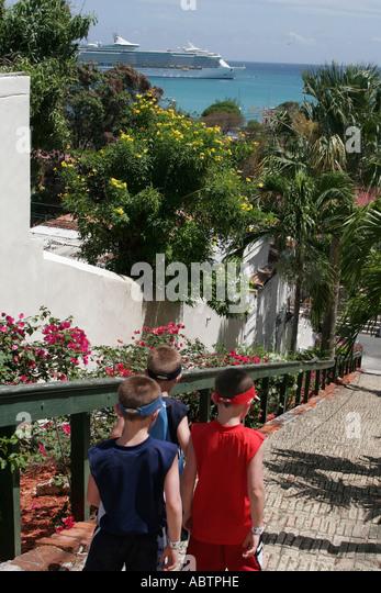 St. Thomas USVI Charlotte Amalie Blackbeard's Hill 99 Steps boys - Stock Image