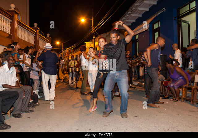 Music and dancing in the street, in the evening, Baracoa, Cuba - Stock Image