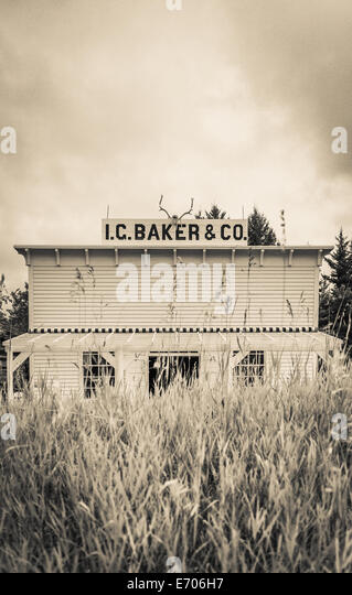 An old antique western general store over the hill on the frontier. - Stock Image