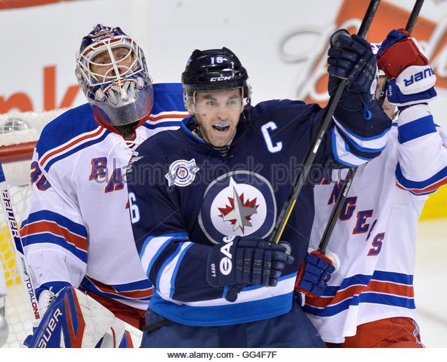 New York Rangers' goaltender Henrik Lundqvist (L) watches the play as he is screened by Winnipeg Jets' Andrew - Stock Image