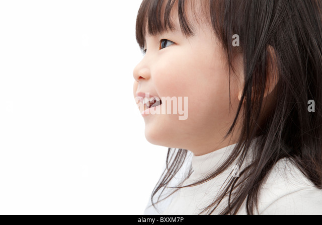 Beautiful asian little girl watch and smiling isolated on white background - Stock Image