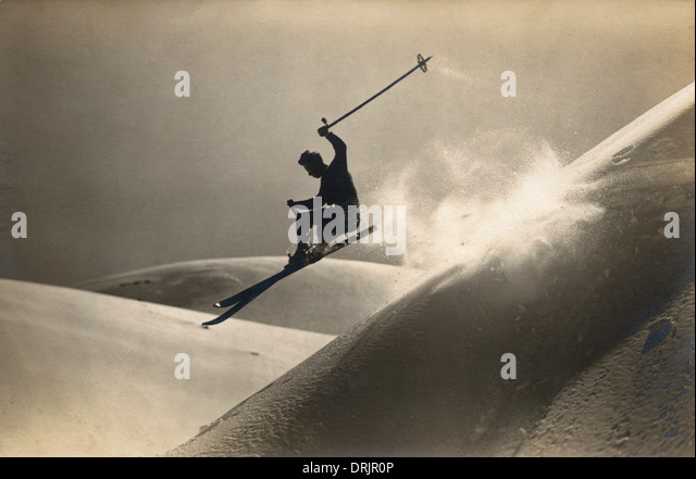 A skier performing stunts downhill. - Stock Image