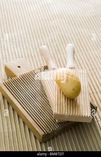 Potato and gnocchi boards - Stock Image