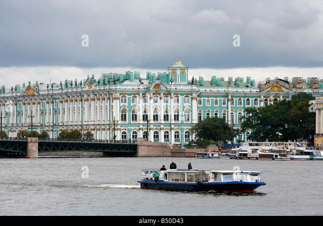 Boat sailing in the Neva River with the Winter Palace in the background St Petersburg Russia - Stock Image