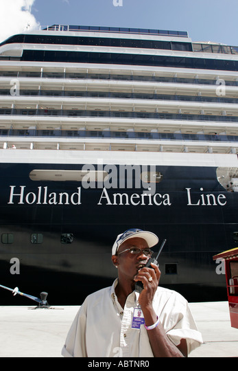 St. Thomas USVI Crown Bay Holland America Line ms Noordam shore excursion group leader Black male tour guide - Stock Image