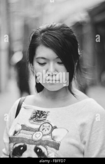 Front View Of Beautiful Woman In City - Stock Image