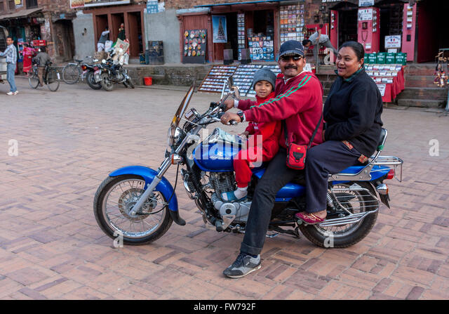 Bhaktapur, Nepal.  Christian Minister with Family on Motorcycle. - Stock Image