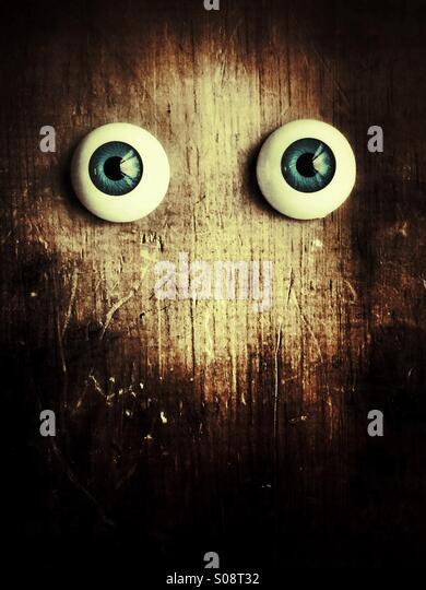 Peeping eyes - Stock Image
