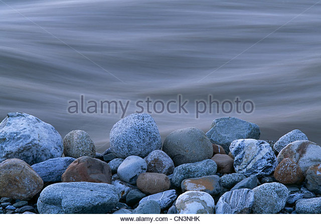 A close-up of the rocks on the shore of the Tashenshini River, Yukon, Canada - Stock Image