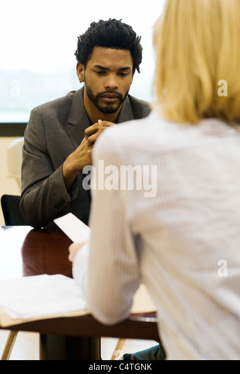 Professional man undergoing job performance evaluation - Stock Image