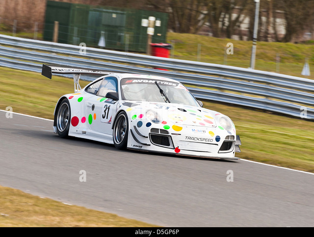 Porsche 997 GT3 R Sports Car in British GT Championship at Oulton Park Motor Racing Circuit Cheshire England United - Stock Image