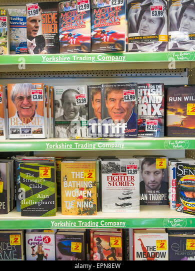 A selection of books for sale in a general store at much reduced prices - Stock Image