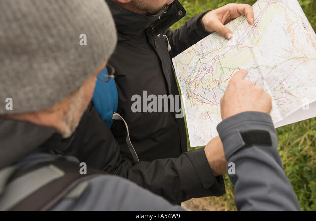 Two mature hikers checking the map for the right way, Austrian Alps, Carinthia, Austria - Stock Image