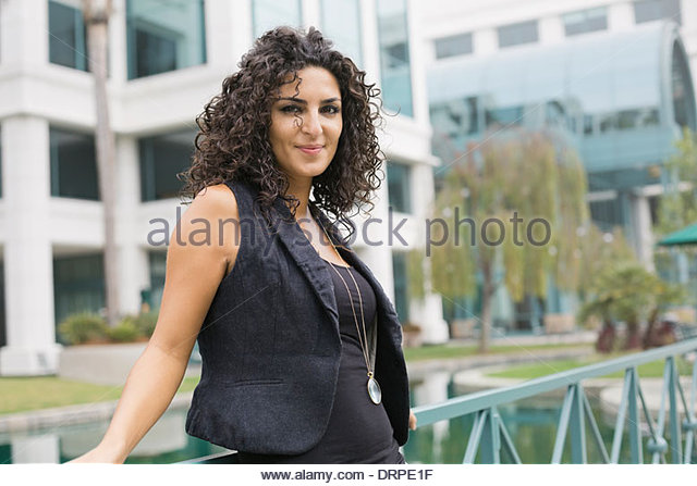 Portrait of beautiful woman outdoors - Stock Image