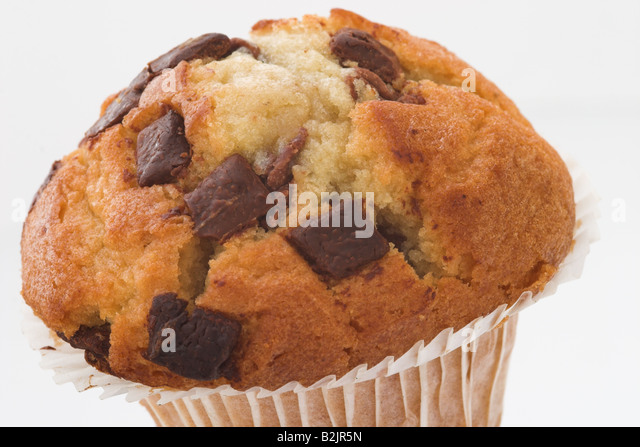 Chocolate Chip Muffin against a white background - Stock Image